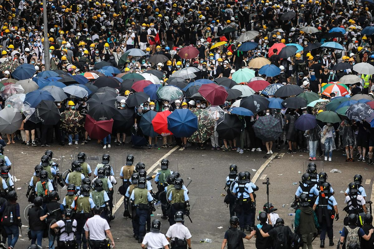 Protesters face off with police during a rally against a controversial extradition law proposal outside the government headquarters in Hong Kong recently.