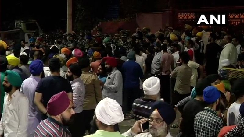 People continue to protest in Mukherjee Nagar against the thrashing of auto driver Sarabjeet Singh and his son by Police, yesterday. Heavy security at the spot.