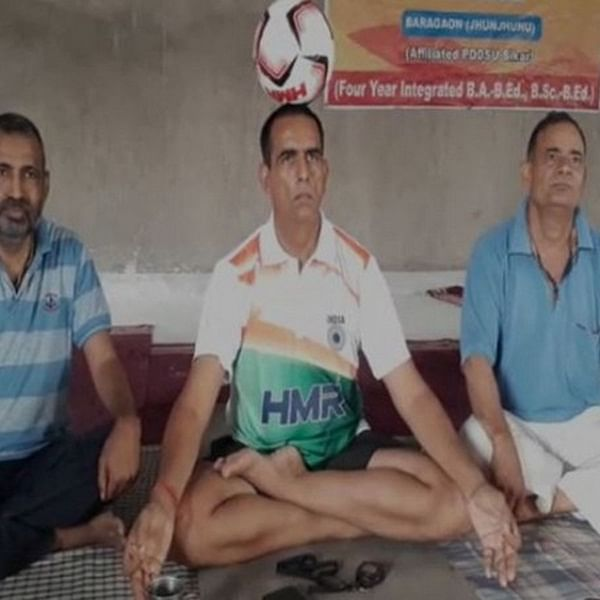 Retired soldier balances ball on head, sets record on Yoga Day
