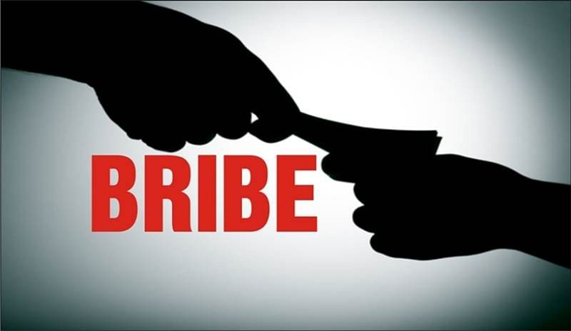 2 NRC officials arrested on charge of accepting bribe