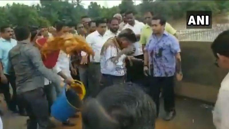 Watch: Congress MLA Nitesh Rane, his supporters throw mud at engineer, tie him to bridge over river