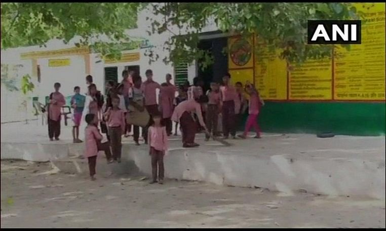 UP: Bulandshahr govt primary school student seen sweeping floor in viral video