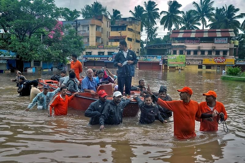 Sangli: NDRF personnel transport residents to safer place due to overflowing Krishna river during monsoon season, in Sangli (PTI Photo) (PTI8_7_2019_000225B)