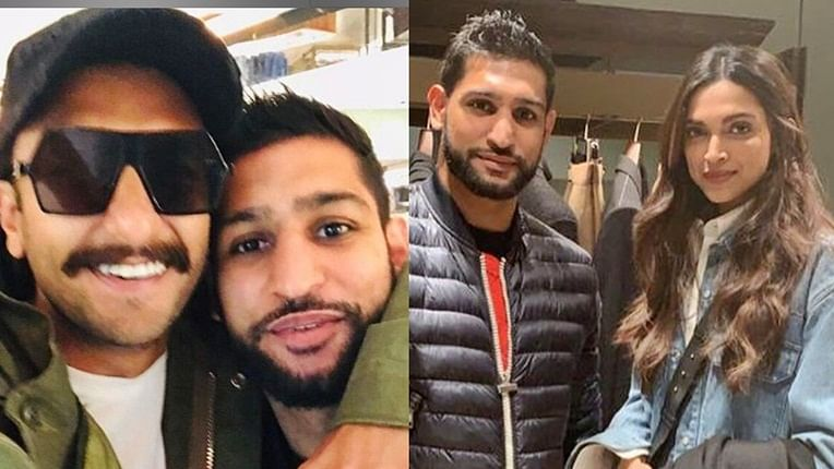 British boxer Amir Khan strikes a pose with Deepika Padukone, Ranveer Singh
