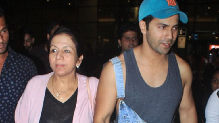 Varun Dhawan becomes a 'Mumma's Boy' as he refuses to let go of Lali Dhawan's hand