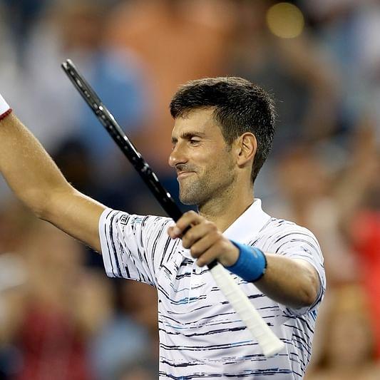 Novak Djokovic motors into Cincinnati quarters, Roger Federer ousted By Bill Scott