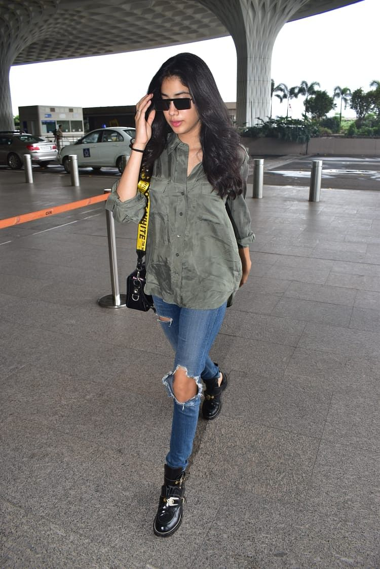 Janhvi who is busy shooting for Gunjan Saxena was also snapped at the airport wearing ripped jeans and olive green shirt.