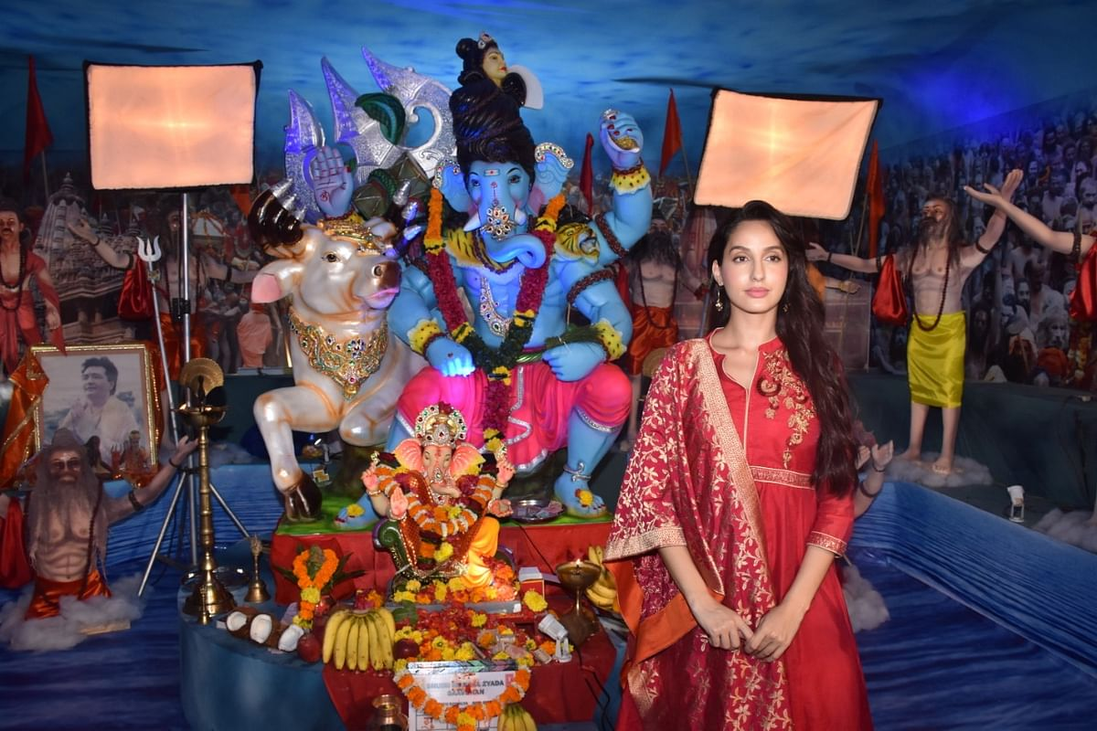 Nora Fatehi who last appeared in 'Batla House' snapped at the T-series Ganpati today.