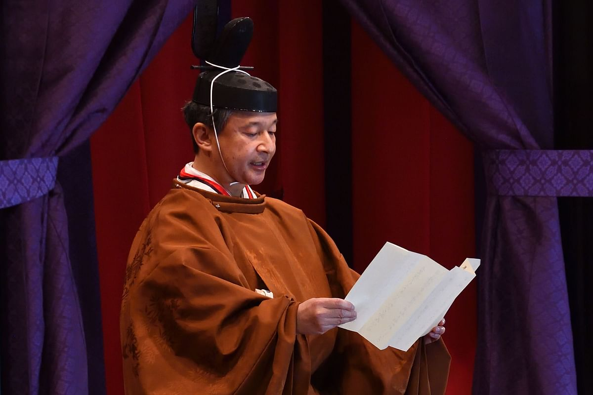Japan's emperor Naruhito ascends throne with ancient rites