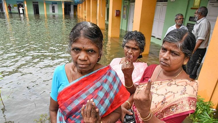 Braving rains and water-logging, people came out in good numbers to cast their votes for Kerala by-polls