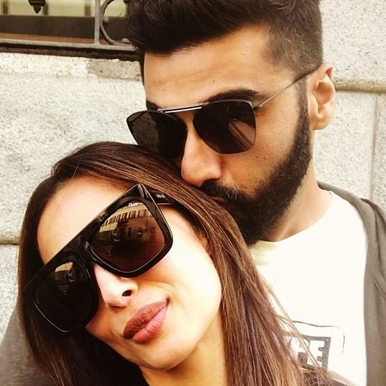 Arjun Kapoor kisses Malaika Arora on her birthday in this latest picture