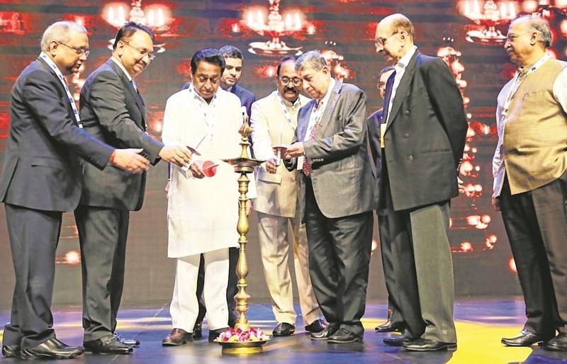 Chief Minister Kamal Nath inaugurates Magnificent MP Investors' Summit along with prominent industrialists including N Srinivasan, Adi Godrej, Dilip Shanghavi, Chandrajeet Banerjee and Vikram Kirloskar. MP Assembly Speaker NP Prajapati is also present.