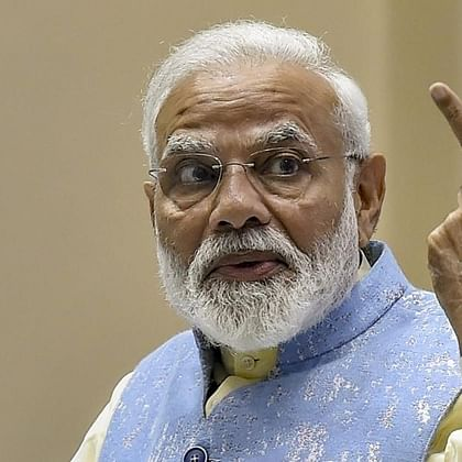 PM Narendra Modi pats party on the back