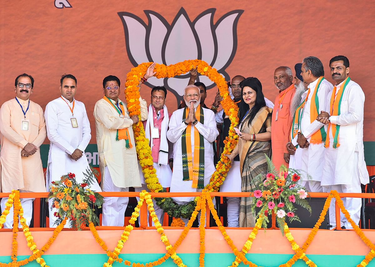 Prime Minister Narendra Modi being garlanded during an election campaign rally ahead of Assembly polls in Sirsa district of Haryana, Saturday, Oct. 19, 2019