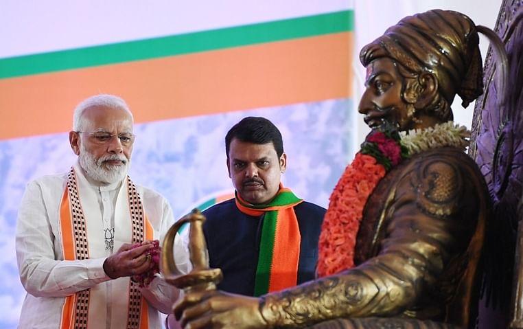 (from left) PM Narendra Modi and CM Devendra Fadnavis paying tribute to Chhatrapati Shivaji Maharaj