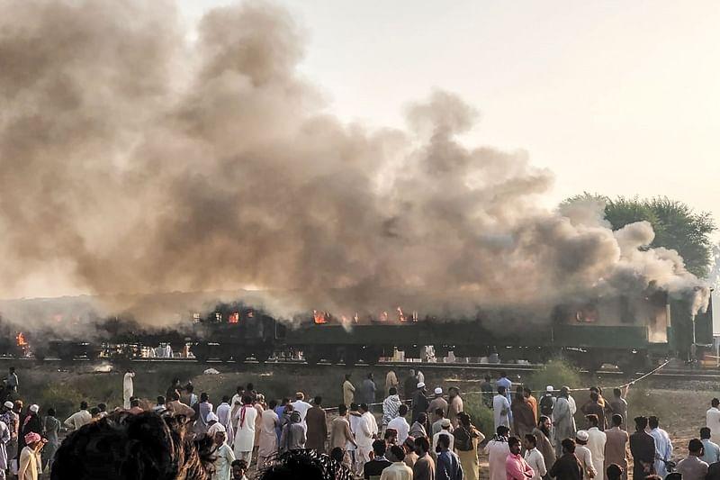 65 dead in Pakistan train fire, 10 bodies identified