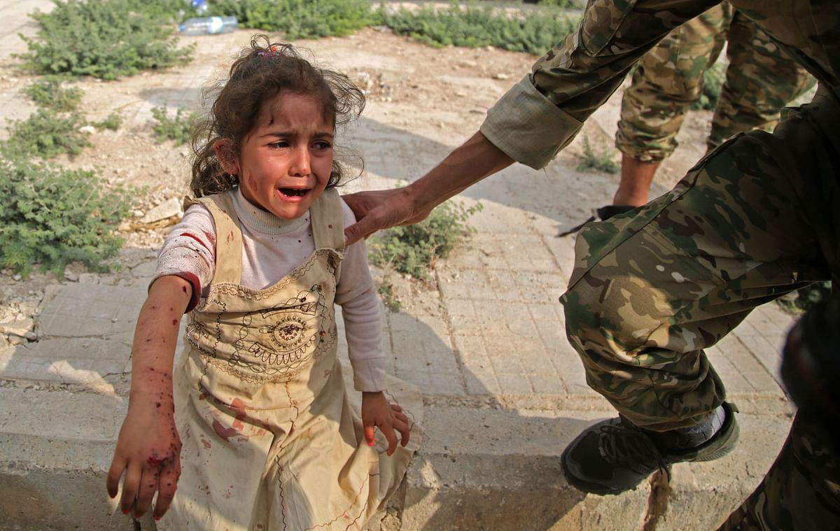Turkey warns to crush heads of Syrian Kurds