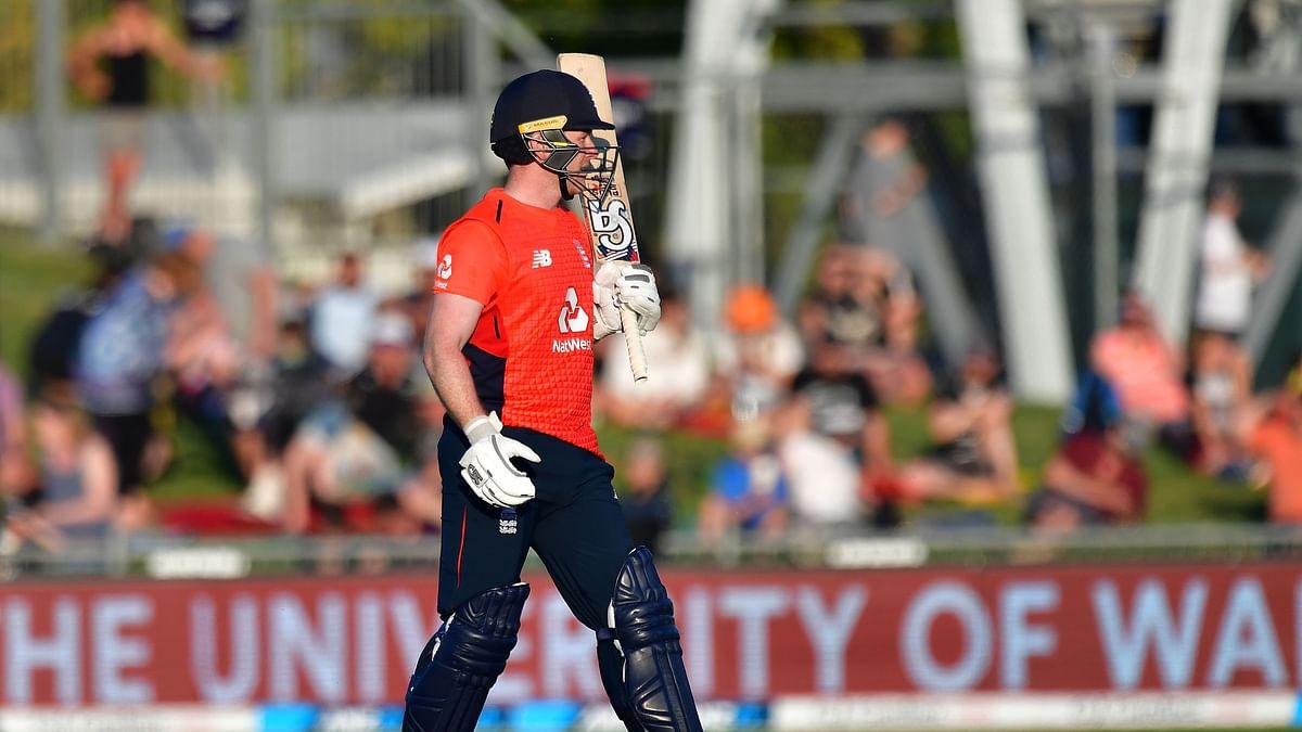 England's captain Eoin Morgan celebrates 50 runs during the Twenty20 cricket match between New Zealand and England