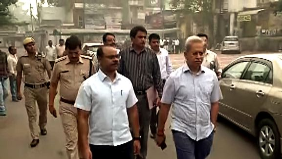 Crime Branch officials Special Commissioner of Police Satish Golcha and DCP Joy Tirkey arrives at the site to investigate the sequence of events at Tis Hazari court in New Delhi.