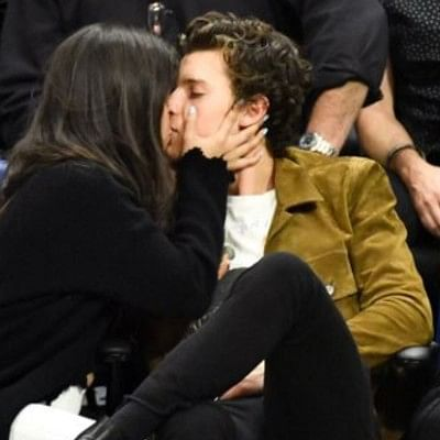 A room isn't enough: Shawn and Camilla's PDA reached heights as they kiss passionately during a night out!