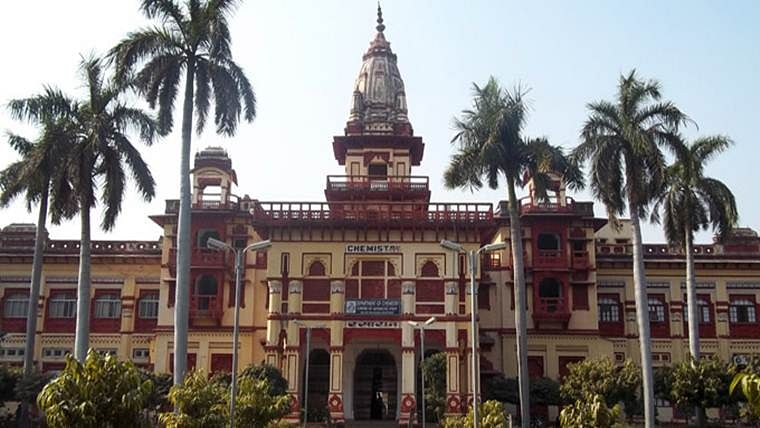RSS a religion now? BHU official fired and charged with 'insulting religious beliefs' for removing RSS flag