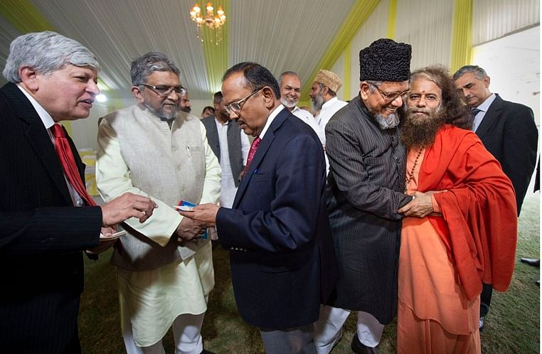 NSA Ajit Doval interacts with religious leaders during an inter-religious faith meeting at his residence in New Delhi, Sunday, Nov. 10, 2019.
