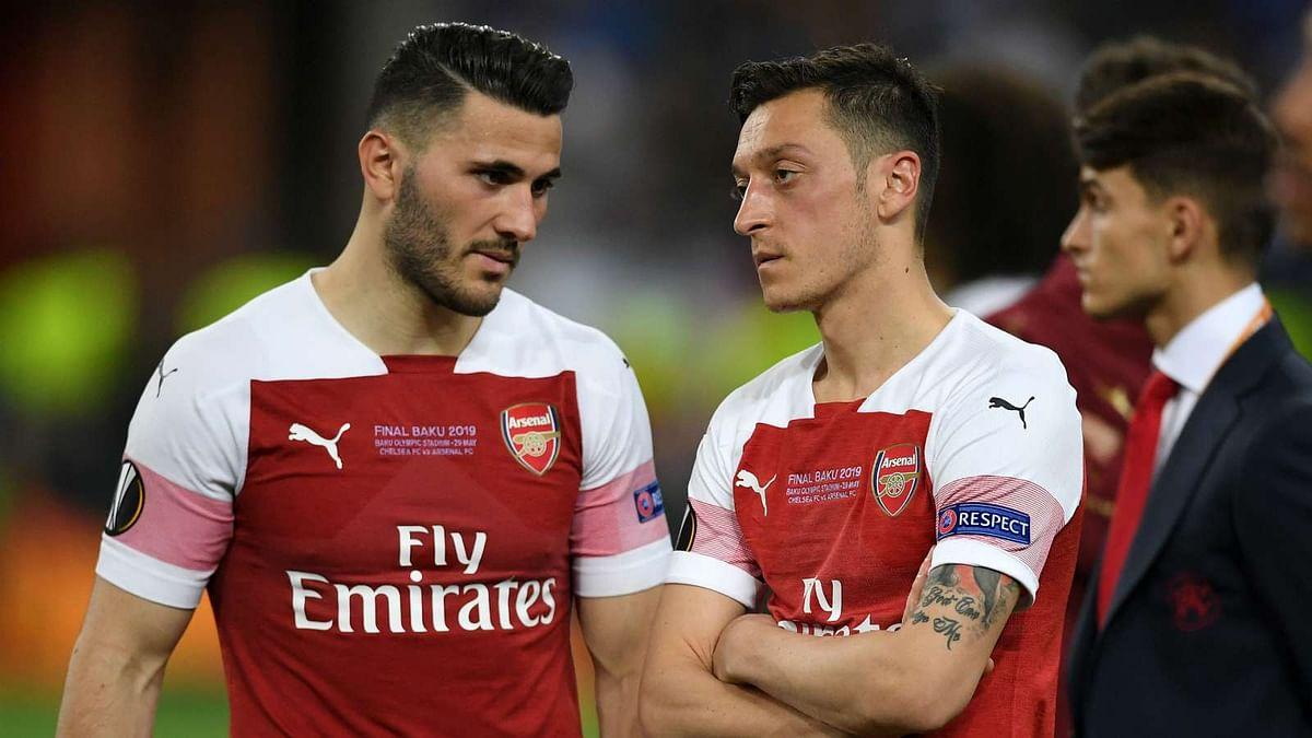 Kolasinac (left) with Mesut Ozil during an Arsenal match