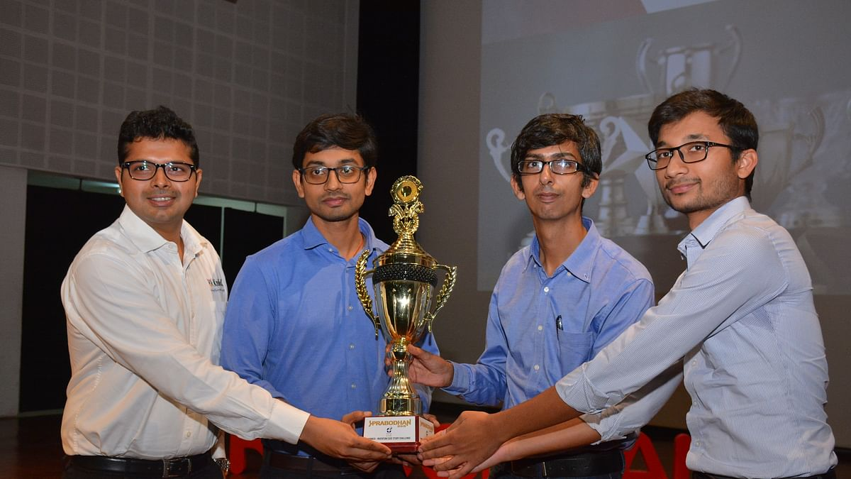 Team IRMA, winner of case study competition, poses for a photo with trophy