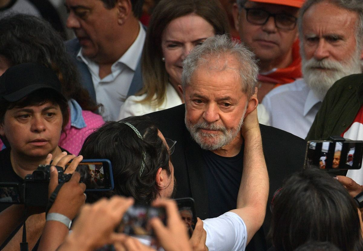 Former Brazilian President Luiz Inacio Lula da Silva is greeted by supporters as he leaves the Federal Police Headquarters, where he was serving a sentence for corruption and money laundering, in Curitiba, Parana State, Brazil, on November 8, 2019.