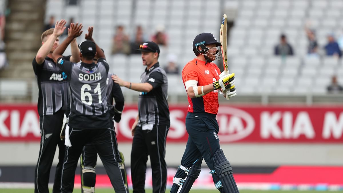 Neesham (L) celebrates the wicket of England's Jonny Bairstow (R) during the 5th Twenty20 cricket match between New Zealand and England at Eden Park in Auckland on November 10, 2019.