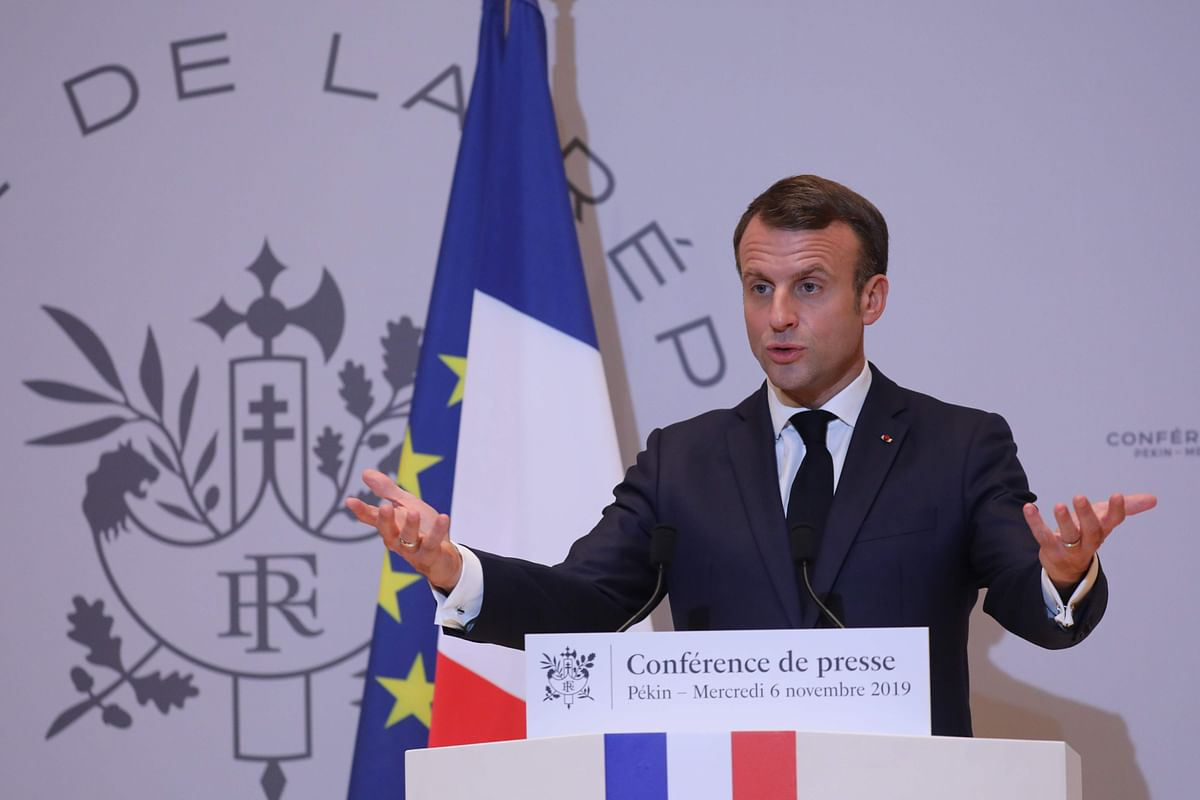 French President Emmanuel Macron holds a press conference at the French embassy.