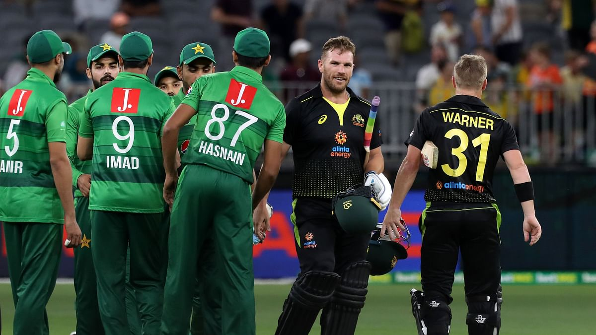 Australia's David Warner (R) and captain Aaron Finch (2nd R) celebrate the victory after the Twenty20 cricket match against Pakistan at Optus Stadium in Perth on November 8, 2019.