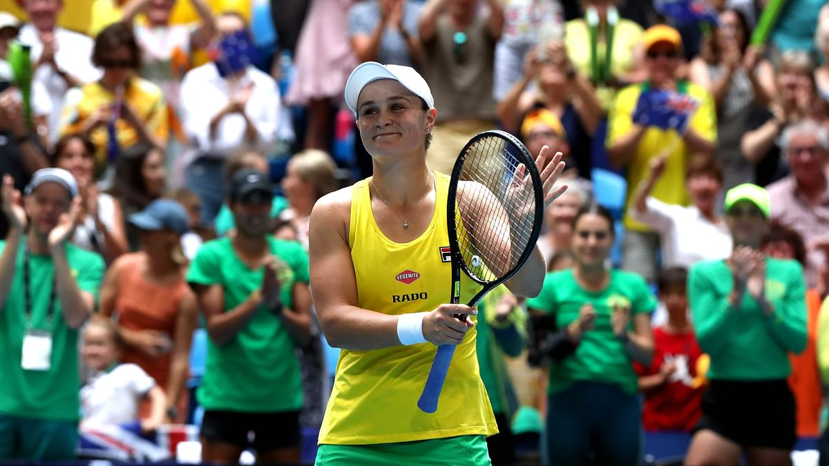 Ashleigh Barty of Australia celebrates after winning the match against Caroline Garcia of France on day one of the Fed Cup Final tennis competition between Australia and France in Perth on November 9, 2019.