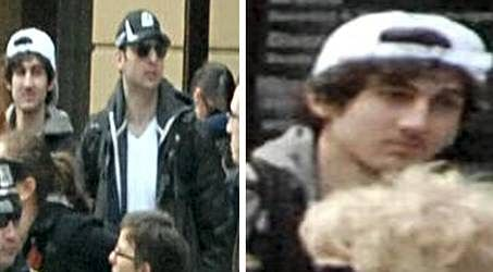 One Boston bombing suspect dead, hunt for another 'armed' man