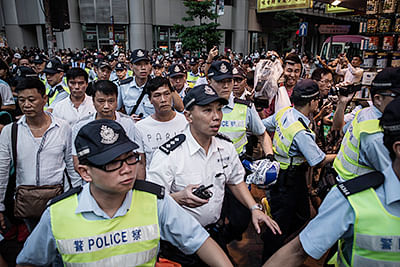 HK protesters defy police with hit-and-run rallies