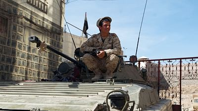 A Shiite Huthi militiaman wearing uniform confiscated from the Yemeni army sits on a government tank in the area around the presidential palace in the capital Sanaa.