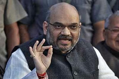 Manmohan made same number of foreign trips as Modi : Amit Shah