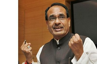 Chouhan submits report on central schemes to PM