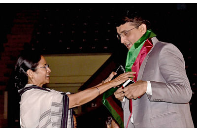 Former cricket captain Sourav Ganguly with West Bengal Chief Minister Mamata Baberjee.