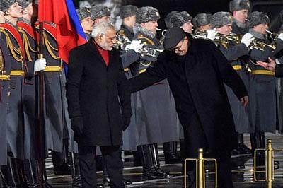 Narendra Modi walks offduring anthem
