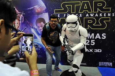 "An Indian Star Wars fan gets himself photographed with a 'Stormtrooper' character from the latest film ""Star Wars: The Force Awakens"" at the 'Mumbai Film and Comic Con 2015' in Mumbai on December 19, 2015."