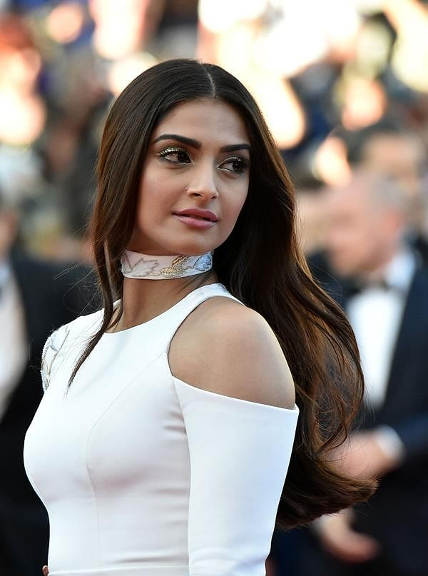 """Sonam Kapoor poses as she arrives on May 15, 2016 for the screening of the film """"Mal de Pierres (From the Land of the Moon)"""" at the 69th Cannes Film Festival in Cannes, southern France."""