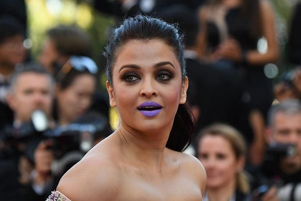 """Indian actress Aishwarya Rai poses as she arrives on May 15, 2016 for the screening of the film """"Mal de Pierres (From the Land of the Moon)"""" at the 69th Cannes Film Festival in Cannes, southern France."""