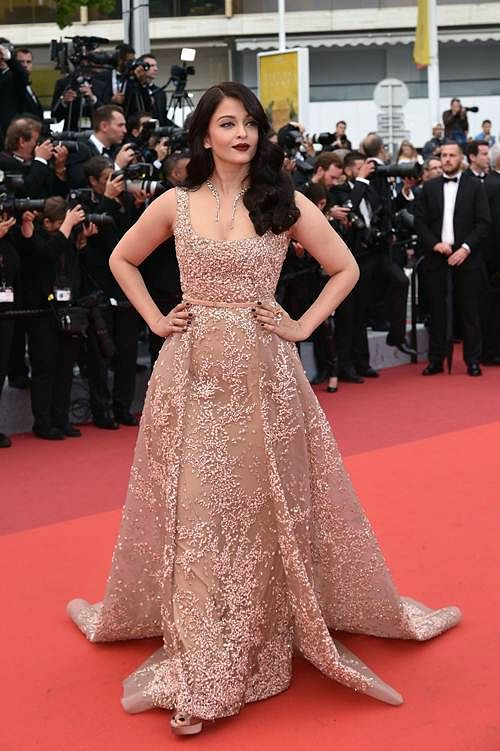 """Indian actress Aishwarya Rai poses as she arrives on May 14, 2016 for the screening of the film """"The BFG"""" at the 69th Cannes Film Festival in Cannes, southern France."""