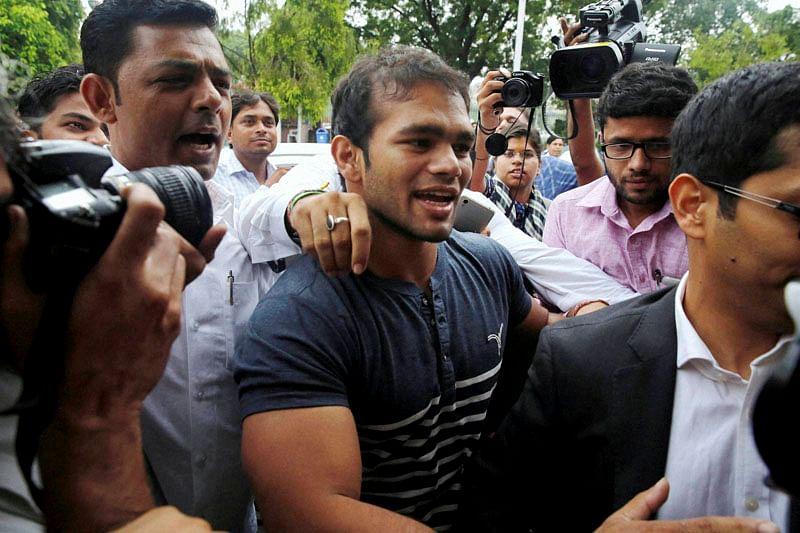 New Delhi: Wrestler Narsingh Yadav arrives at NADA office in New Delhi on Wednesday. PTI Photo by Shahbaz Khan(PTI7_27_2016_000242B)