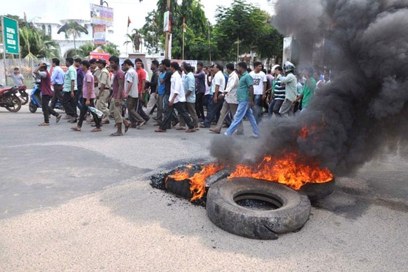 Angry mob block roads, burn tyres in demand of petrol in Agartala