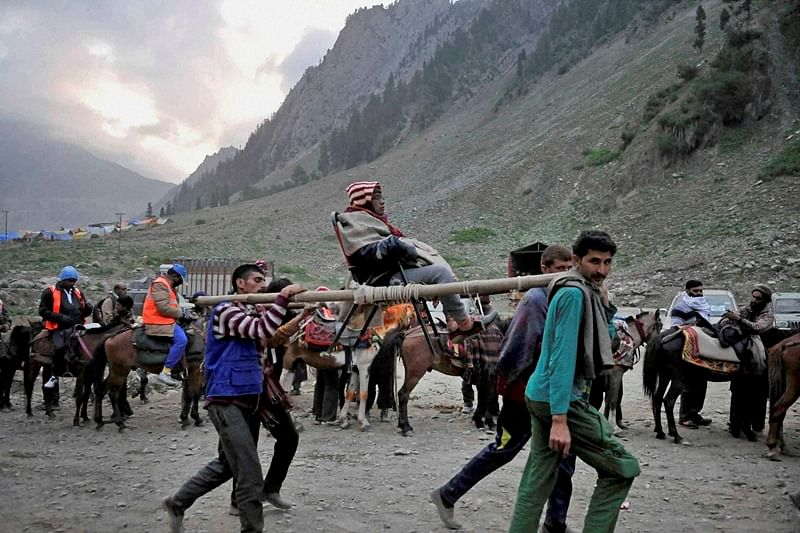 Ppilgrims cross the Dumail gate as they move towards Amarnath holy cave Shrine at an height of 3880 Meters, housing naturally formed ice - Lingam, symbol of Lord Shiva