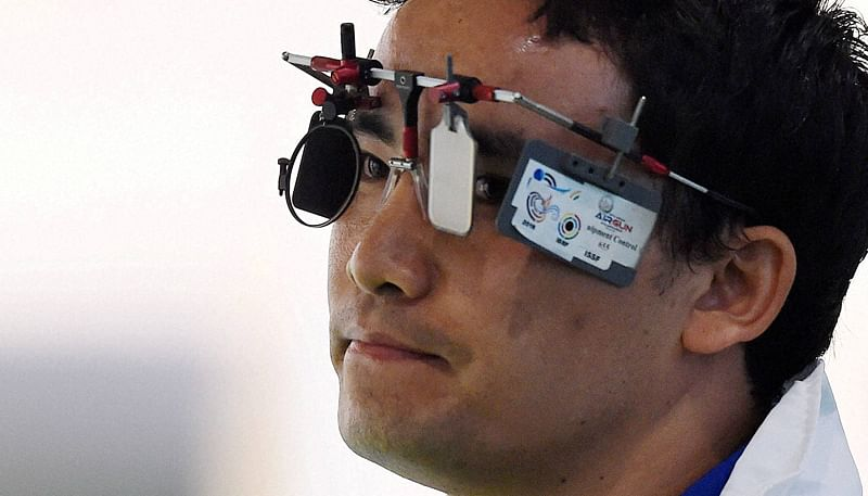 Rio de Janeiro: India's Jitu Rai reacts during the Men's 50m Pistol qualifying round at the Summer Olympic 2016 at Rio de Janeiro, Brazil on Wednesday. PTI Photo by Atul Yadav (PTI8_10_2016_000269B)
