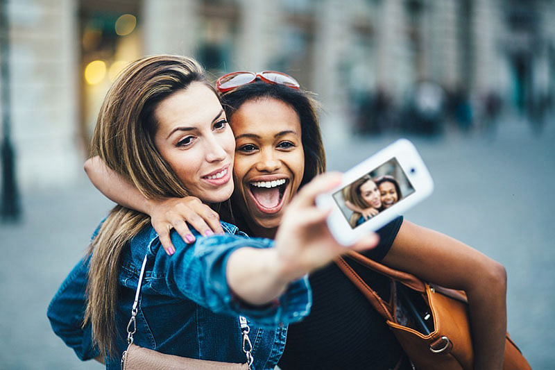 Clicking, sharing smiling selfies help you beat the blues