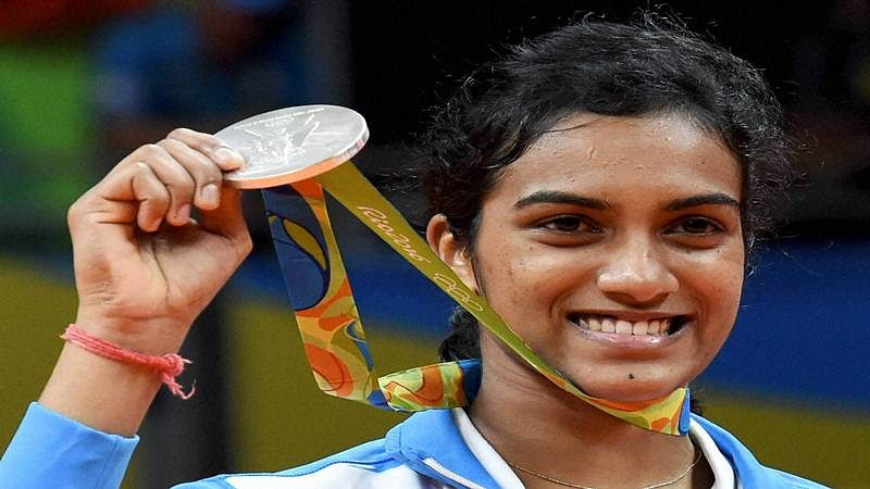 Rio de Janeiro: India's Pusarla V Sindhu poses with her silver medal after her match with Spain's Carolina Marin in women's Singles final at the 2016 Summer Olympics at Rio de Janeiro in Brazil on Friday. PTI Photo by Atul Yadav      (PTI8_19_2016_000296B)